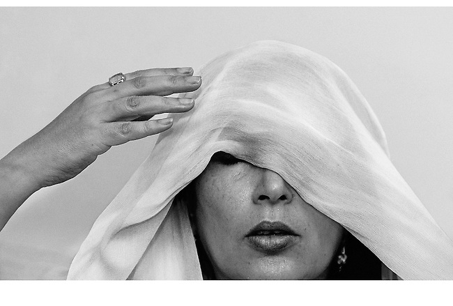 KARACHI, PAKISTAN - OCTOBER 21:  Former Pakistani premier Benazir Bhutto adjusts her head scarf during a press conference at her house in Karachi on October 21, 2007 in Karachi, Pakistan.  Bhutto held prayers for those killed in the deadly suicide attack on her homecoming parade. Bhutto returned on Thursday from self-imposed exile after eight years, she blamed Islamist militants for carrying out the bombing, where 139 people were killed.  (Photo by Daniel Berehulak/Getty Images)