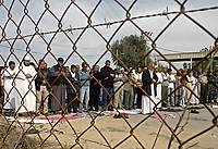 """Palestinian Muslim pilgrims stage a protest to demand that Palestinian Muslim pilgrims pray next to the border between the southern Gaza Strip and Egypt as part of a protest calling for the opening of the Rafah border crossing to allow them to go to the Hajj in Saudi Arabia, Thursday, Nov. 29, 2007. Gaza's borders have been largely closed-off since June 2007, when the militant Hamas group took over.  """" photo by Fady Adwan"""""""