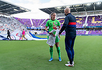 ORLANDO, FL - FEBRUARY 21: Alyssa Naeher #1 talks to Philip Poole of the USWNT before a game between Brazil and USWNT at Exploria Stadium on February 21, 2021 in Orlando, Florida.