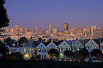 Retro Image of Victorian Homes along Steiner Street with city lights at dusk, San Francisco, California USA