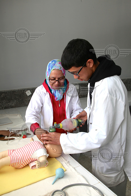 Students being trained to deliver primary care to newborn babies in the neonatology unit at the Ghassani Hospital.