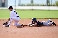 FCL Yankees Cooper Bowman (29) slides head first into second base as Austin Schultz (26) fields a throw during a game against the FCL Tigers West on July 31, 2021 at Tigertown in Lakeland, Florida.  (Mike Janes/Four Seam Images)