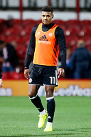 Ollie Watkins of Brentford warms up during the Sky Bet Championship match between Brentford and Derby County at Griffin Park, London, England on 26 September 2017. Photo by Carlton Myrie / PRiME Media Images.