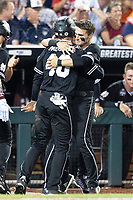 Mississippi State Bulldogs outfielder Jake Mangum (15) hugs teammate Elijah MacNamee (40) during Game 4 of the NCAA College World Series against the Auburn Tigers on June 16, 2019 at TD Ameritrade Park in Omaha, Nebraska. Mississippi State defeated Auburn 5-4. (Andrew Woolley/Four Seam Images)