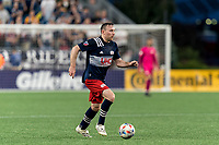 FOXBOROUGH, MA - AUGUST 18: Tommy McNamara #26 of New England Revolution dribbles during a game between D.C. United and New England Revolution at Gillette Stadium on August 18, 2021 in Foxborough, Massachusetts.
