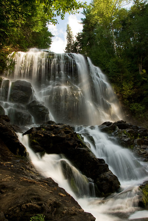 Taken from just below the upper drop of the falls, on a puffy-cloud summer day in Colebrook NH, 2009.