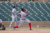 Mesa Solar Sox center fielder Victor Robles (14) of the Washington Nationals organization, follows through on his swing during an Arizona Fall League game against the Salt River Rafters on October 30, 2017 at Salt River Fields at Talking Stick in Scottsdale, Arizona. The Solar Sox defeated the Rafters 8-4. (Zachary Lucy/Four Seam Images)