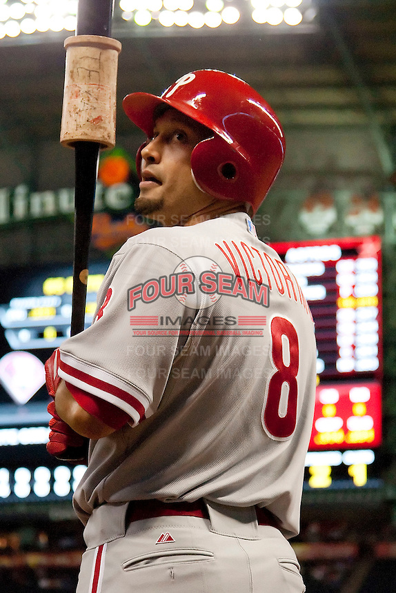Philadelphia Phillies pinch hitter Shane Victorino #8 on deck during the Major League Baseball game against the Houston Astros at Minute Maid Park in Houston, Texas on September 13, 2011. Houston defeated Philadelphia 5-2.  (Andrew Woolley/Four Seam Images)