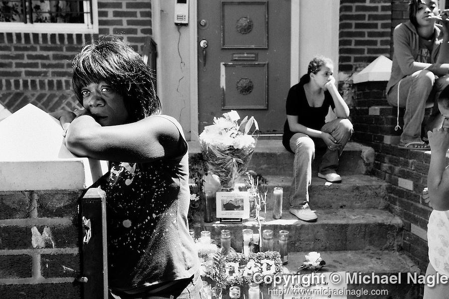 BROOKLYN -- JUNE 7, 2007: Renette Robinson, 46, (L) mourns at a memorial in front of 40 Lott avenue, where her 21 year-old nephew Michael Robinson was killed last night along with Delroy Gumbs, 19, and Brandon Graves, 16, on June 7, 2007 in Brownsville, Brooklyn.  (PHOTOGRAPH BY MICHAEL NAGLE)