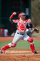 Billy Walker (25) of the Hartford Hawks makes a throw to second base during infield practice prior to the game against the Virginia Cavaliers at The Ripken Experience on February 27, 2015 in Myrtle Beach, South Carolina.  The Cavaliers defeated the Hawks 5-1.  (Brian Westerholt/Four Seam Images)