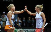 Arena Loire,  Trélazé,  France, 16 April, 2016, Semifinal FedCup, France-Netherlands, Doubles:  Hogenkamp (R) Bertens (NED) giving hi-five<br /> Photo: Henk Koster/Tennisimages