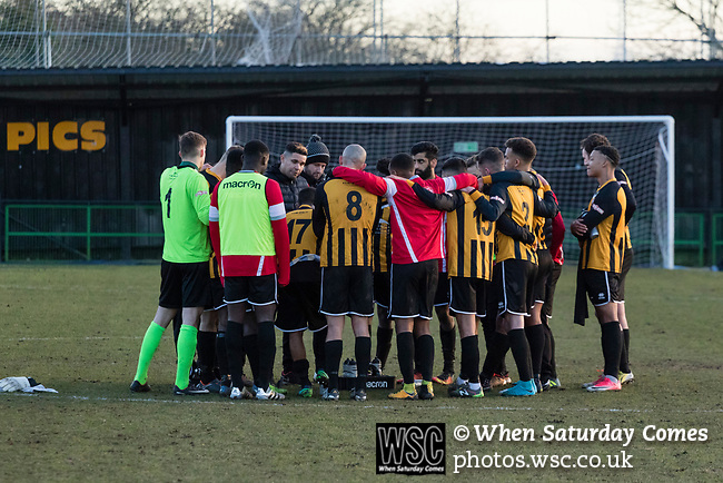 Rushall Olympic 1 Workingon 0, 17/02/2018. Dales Lane, Northern Premier League Premier Division. Rushall players being addressed by Liam McDonald after the final whistle. Photo by Paul Thompson. Rushall Olympic 1 Workingon 0, Northern Premier League Premier Division, 17th February 2018. Rushall is a former mining village now part of the northern suburbs of Walsall.