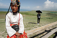 A Tibetan girl near to Qinghai Lake. Qinghai Lake, China's largest inland body of water lies at over 3000m on the Qinghai-Tibetan Plateau. The lake has been shrinking in recent decades, as a result of increased water-usage for local agriculture. Qinghai Province. China. 2010