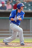 Chattanooga Lookouts Right Fielder Kyle Russell #23 swings at a pitch during a game against the Tennessee Smokies at Smokies Park on June 18, 2011 in Kodak, Tennessee.  Chattanooga defeated Tennessee 5-3.  (Tony Farlow/Four Seam Images)
