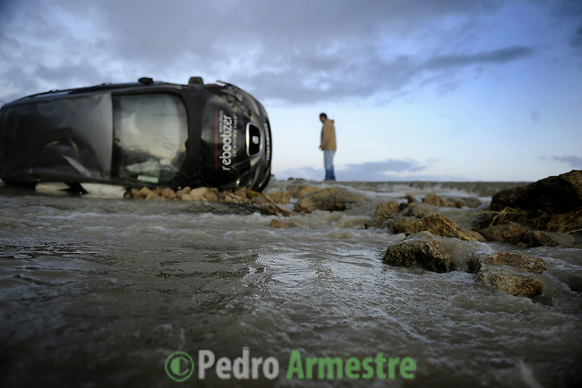 A wrecked car is seen on the road of La Ina, near Jerez de la Frontera in Cadiz is pictured after it was closed on january 05, 2010 for the heavy rain. (c)Pedro ARMESTRE.