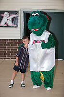 A young fan poses for a photo with Kannapolis Intimidators mascot Tim E. Gator prior to the game against the West Virginia Power at Kannapolis Intimidators Stadium on June 18, 2017 in Kannapolis, North Carolina.  The Intimidators defeated the Power 5-3 to win the South Atlantic League Northern Division first half title.  It is the first trip to the playoffs for the Intimidators since 2009.  (Brian Westerholt/Four Seam Images)