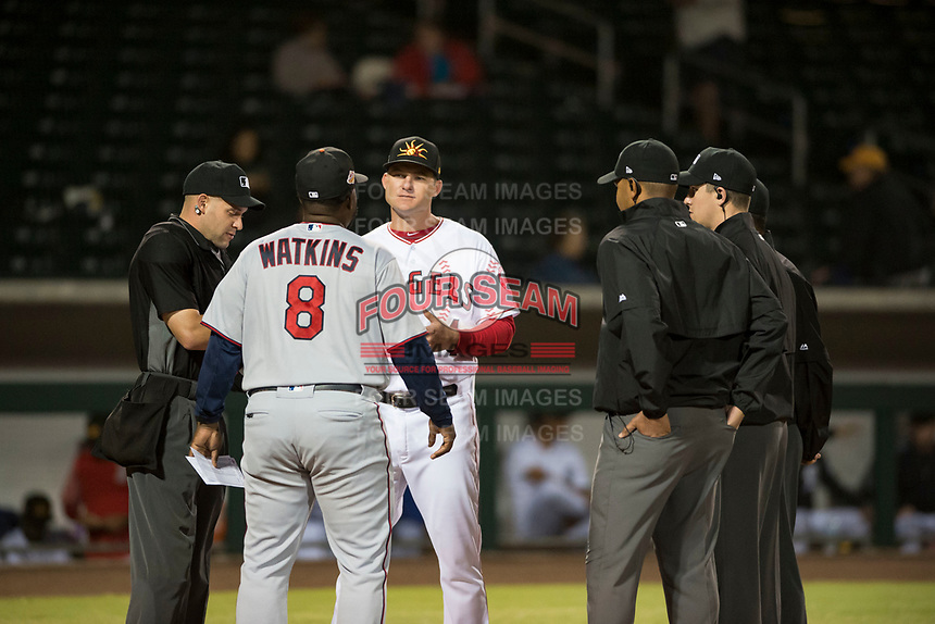 Mesa Solar Sox manager Lou Marson (4), of the Los Angeles Angels organization, and Salt River Rafters manager Tommy Watkins (8), of the Minnesota Twins organization, meet with umpires Dan Merzel, Brennan Miller, Nestor Ceja, and Jeremie Rehak before an Arizona Fall League game at Sloan Park on October 16, 2018 in Mesa, Arizona. Salt River defeated Mesa 2-1. (Zachary Lucy/Four Seam Images)