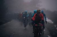 Team Bahrein-Merida rider piloting the peloton through the thick mist<br /> <br /> 76th Paris-Nice 2018<br /> Stage 7: Nice > Valdeblore La Colmiane (175km)