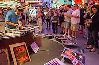 Las Vegas, Nevada.  Fremont Street.  Artist Demonstrating his Skill with Aerosol Spray Paint.