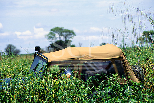 """Chipundu, Zambia. Four wheel drive jeeps crossing a swamp """"cross country""""."""