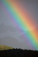 A Rainbow over the mountains of Chugach Natoinal Forest as seen from Seward, Alaska