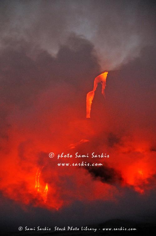Steam rising off lava flowing into ocean, Kilauea Volcano, Hawaii Islands, United States