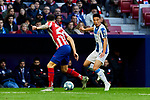 Mario Hermoso of Atletico de Madrid and Wu Lei of RCD Espanyol during La Liga match between Atletico de Madrid and RCD Espanyol at Wanda Metropolitano Stadium in Madrid, Spain. November 10, 2019. (ALTERPHOTOS/A. Perez Meca)