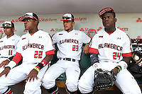 Nick Plummer (11), Nicholas Shumpert (22), Anthony Molina (23) and Starling Heredia (24) sit in the dugout before the Under Armour All-American Game on August 16, 2014 at Wrigley Field in Chicago, Illinois.  (Mike Janes/Four Seam Images)