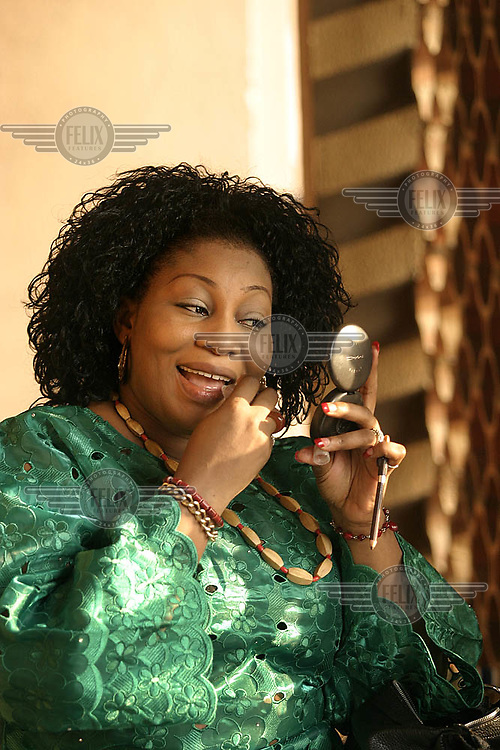 Nollywood, Nigerian movie industry at work. Actress Nneka Onykwulujem prepares for a sceen in a film directed by Adim Williams.<br />  © Fredrik Naumann
