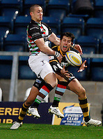 Photo: Richard Lane/Richard Lane Photography. London Wasps v Harlequins. 04/12/2011. Wasps' Hug Southwell catches the ball as he is tackled by Quins' Mike Brown.