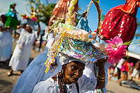 A Baiana woman carries a religious figurine during the ritual procession in honor to Yemanjá, the Candomblé goddess of the sea, in Amoreiras, Bahia, Brazil, 3 February 2012. Yemanjá, originally from the ancient Yoruba mythology, is one of the most popular ?orixás?, the deities from the Afro-Brazilian religion of Candomblé. Every year on February 3rd, hundreds of Yemanjá devotees participate in a colorful celebration in her honor. Faithful, usually dressed in the traditional white, gather at the beach on Itaparica island to leave offerings for their goddess. Gifts for Yemanjá include flowers, perfumes or jewelry. Dancing in the circle and singing ancestral Yoruba prayers, sometimes the followers enter into a trance and become possessed by the spirits. Although Yemanjá is widely worshipped throughout Latin America, including south of Brazil, Uruguay, Cuba or Haiti, the most popular cult is maintained in Bahia, Brazil.