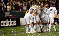 The LA Galaxy celebrate together after David Beckham's 50 plus yard empty net goal late in the second half during a MLS match. The LA Galaxy defeated the Kansas City Wizards 3-1 at Home Depot Center stadium in Carson, Calif., on Saturday, May 24, 2008.