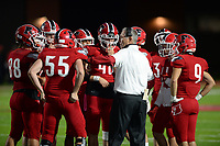 Farmington coach Mike Adams speaks to his team Friday, Oct. 16, 2020, during the first half of play against Clarksville at Cardinal Stadium in Farmington. Visit nwaonline.com/201017Daily/ for today's photo gallery. <br /> (NWA Democrat-Gazette/Andy Shupe)