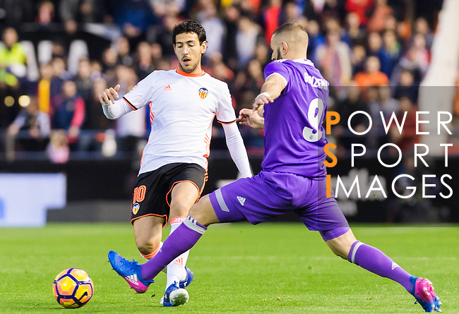 Karim Benzema (r) of Real Madrid fights for the ball with Daniel Parejo Munoz of Valencia CF during their La Liga match between Valencia CF and Real Madrid at the Estadio de Mestalla on 22 February 2017 in Valencia, Spain. Photo by Maria Jose Segovia Carmona / Power Sport Images