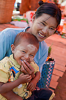Myanmar, Burma.  Burmese Mother and Son, Inle Lake, Shan State.  They are wearing thanaka paste on their faces, a Burmese cosmetic sunscreen.