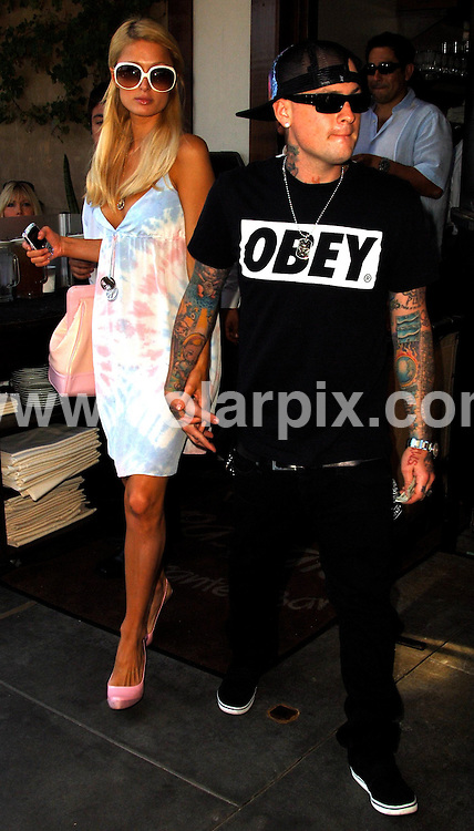 **ALL ROUND PICTURES FROM SOLARPIX.COM**.**WORLDWIDE SYNDICATION RIGHTS EXCEPT FOR USA, AUSTRALIA & GERMANY**.Paris Hilton and Benji Madden leaving Il Pastaio restaurant in Beverly Hills after having lunch in Beverly Hills, California, USA. 25th August 2008..JOB REF: 7116 LAS       DATE: 25_08_2008.**MUST CREDIT SOLARPIX.COM OR DOUBLE FEE WILL BE CHARGED* *UNDER NO CIRCUMSTANCES IS THIS IMAGE TO BE REPRODUCED FOR ANY ONLINE EDITION WITHOUT PRIOR PERMISSION*