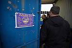 City of Liverpool 6 Holker Old Boys 1, 10/12/2016. Delta Taxis Stadium, North West Counties League Division One. Spectators paying into the ground at the Delta Taxis Stadium, Bootle, Merseyside before City of Liverpool hosted Holker Old Boys in a North West Counties League division one match. Founded in 2015, and aiming to be the premier non-League club in Liverpool, City were admitted to the League at the start of the 2016-17 season and were using Bootle FC's ground for home matches. A 6-1 victory over their visitors took 'the Purps' to the top of the division, in a match watched by 483 spectators. Photo by Colin McPherson.