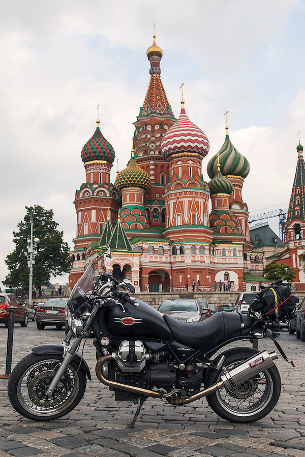 Moscow, Russia, 12/08/2013.<br /> Moto Guzzi Bellagio on Vasilyevsky Spusk by Red Square with St Basil's Cathedral behind.