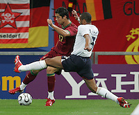 Cristiano Ronaldo, Ashley Cole.  Portugal defeated England on penalty kicks after playing to a 0-0 tie in regulation in their FIFA World Cup quarterfinal match at FIFA World Cup Stadium in Gelsenkirchen, Germany, July 1, 2006.