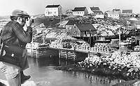 Peggy's Cove: This picturesque area is crowded in season and everyone pours into the one restaurant; ther Sou'Wester; a large eatery where the service is fast and the food prepared by 'superstar' wives of the fishermen.<br /> <br /> <br /> Griffin, Doug<br /> Picture, 1973,