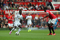 Pictured L-R: Nathan Dyer of Swansea against Tyler Blackett of Manchester United. Saturday 16 August 2014<br /> Re: Premier League Manchester United v Swansea City FC at the Old Trafford, Manchester, UK.
