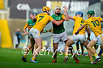 Jason Diggins, Kerry in action against Joe Maskey, Antrim and Gerard Walsh, Antrim during the Joe McDonagh Cup Final match between Kerry and Antrim at Croke Park in Dublin.