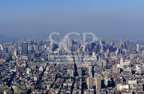 New York, USA. Skyline of uptown Manhattan with Empire State, Chrysler and Met Life Buildings from World Trade Centre.