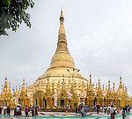 21 JUNE 2015, YANGON, MYANMAR:  The Shwedagon Pagoda is a gilded stupa located in Yangon, Myanmar. The 99 metres (325 ft) tall[ pagoda is situated on Singuttara Hill, and dominates the Yangon skyline.<br /> Shwedagon Pagoda is the most sacred Buddhist pagoda in Myanmar, as it is believed to contain relics of the four previous Buddhas of the present kalpa. These relics include the staff of Kakusandha, the water filter of Koṇāgamana, a piece of the robe of Kassapa, and eight strands of hair from the head of Gautama.Picture Graham Crouch/The Australian Magazine