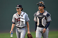 Starting pitcher Ian Anderson (19) of the Rome Braves walks to the dugout with catcher Drew Lugbauer before a game against the Greenville Drive on Saturday, August 12, 2017, at Fluor Field at the West End in Greenville, South Carolina. Rome won, 4-0. (Tom Priddy/Four Seam Images)