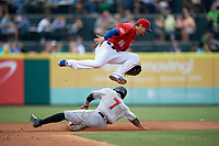 Buffalo Bisons shortstop Shane Opitz (16) jumps over a sliding Chris Bostick (7) during a game against the Indianapolis Indians on August 17, 2017 at Coca-Cola Field in Buffalo, New York.  Buffalo defeated Indianapolis 4-1.  (Mike Janes/Four Seam Images)