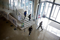 Visitors walk through the lobby of the Sloan School of Management during the MIT Under the Dome open house in Cambridge, Massachusetts, USA