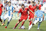 CD Leganes' Ruben Perez (l) and Victor Diaz (r) and Sevilla FC's Franco Vazquez during La Liga match. October 15,2016. (ALTERPHOTOS/Acero)