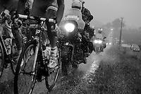 moto l'Equipe in the peloton during a thunder storm<br /> <br /> 2014 Tour de France<br /> stage 19: Maubourguet - Bergerac (208km)