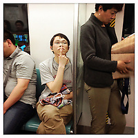 Beijingers travelling on the subway in Beijing, China.